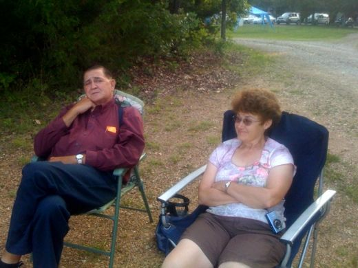 Mom & Dad watching softball.