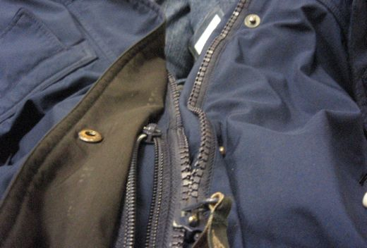 It's the zipper on the right.  The other is my secret pocket.