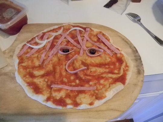 Pizza face, but not like in high school.
